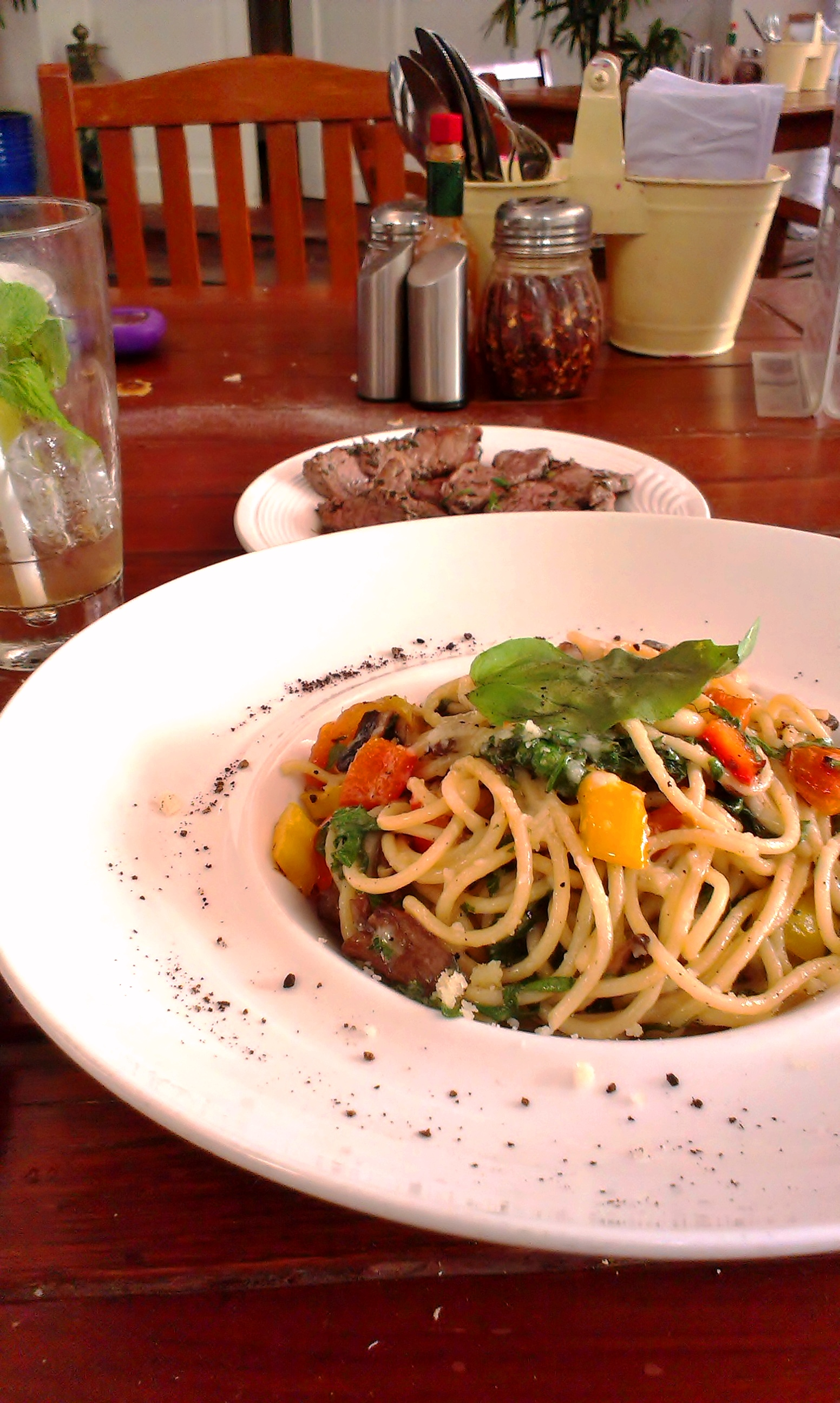 Spaghetti aglio e olio accompanied with a side of steak strips